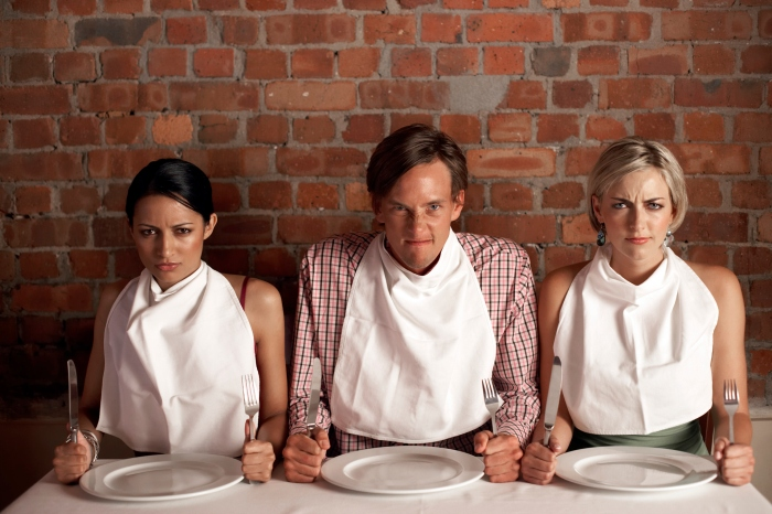 three-people-wearing-napkins-around-their-necks-1410356925